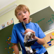 Stock Photo: Boy with microscope