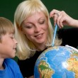 The woman and the boy with globe — Stock Photo