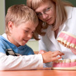 Dentist and boy with jaw - Stock Photo