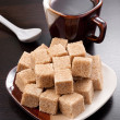 Brown sugar cubes and coffee cup - Stock Photo