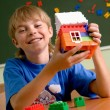 Boy with small house — Stock Photo #1437475