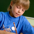 Stock Photo: Boy draw using the pencil