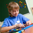 Boy  with puzzles - Foto Stock