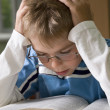 Boy is concentrated with reading — Stock Photo