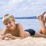 Happy small boy in sand — Stock Photo