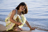 Girl on seacoast — Stock Photo