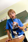 Boy with microscope — Stock Photo