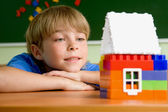 Boy with small toy house — Stock Photo
