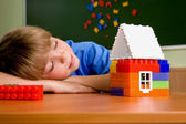 The boy with toy house — Stock Photo