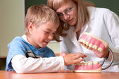 Dentist and boy with jaw — Stock Photo