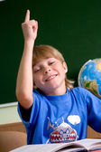 Tired schoolboy with his hand up — Stock Photo