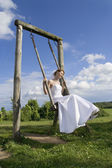Bride on a swing — Stock Photo