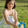 Lovely little girl on green grass — Stock Photo