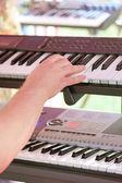 Hand on synthesizer — Stock Photo