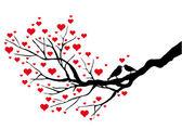 Aves besándose en un árbol de corazón — Vector de stock
