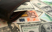 100 dollar bill in leather brown purse — Stock Photo