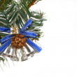 Silver bells on branch fir — Stock Photo