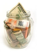 Dollar and euro bills in glass jar — Stock Photo