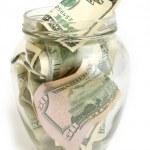 Dollar bills in glass jar — Stock Photo