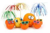 Funny orange, lemon and mandarins — Stock Photo