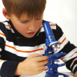 The boy with a microscope — Stock Photo #1864488