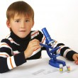 The boy with microscope — Stock Photo