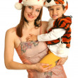 Mother with baby in fancy dresses — Stock Photo