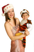 Mother with baby in fancy dress — Stock Photo
