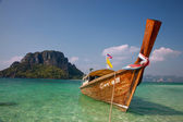 Boat and rock near tropical island — Stock Photo
