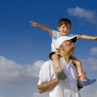 Child on man shoulders — Stock Photo