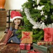 Little girl with Christmas tree — Stockfoto