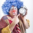 Unhappy clown with alam clock — Stok fotoğraf