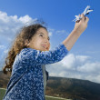 Little girl toy airplane — Stock Photo