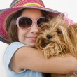 Young girl with a yorkshire terrier — Stock Photo