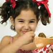 Girl eating falafel - Stock Photo