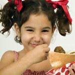 Girl eating falafel — Stock Photo #1339043