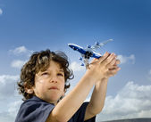 Little boy toy airplane — Stock Photo