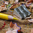 Yellow pencil and shavings - Stock Photo