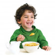 Kid eating cereals — Stock Photo