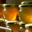 Honey jars on a shelf — Stock Photo