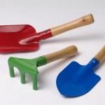Three kids garden tools — Stock Photo