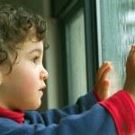 Little boy watching the rain — Stock Photo