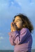 Little girl making a wish — Stock Photo