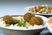 Hummus falafel and arabic salad — Stock Photo