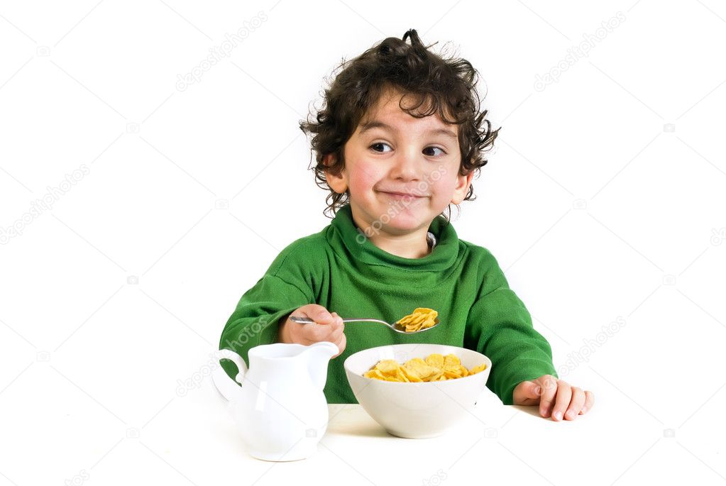 Young boy eating cereals isolated on white — Photo #1340938