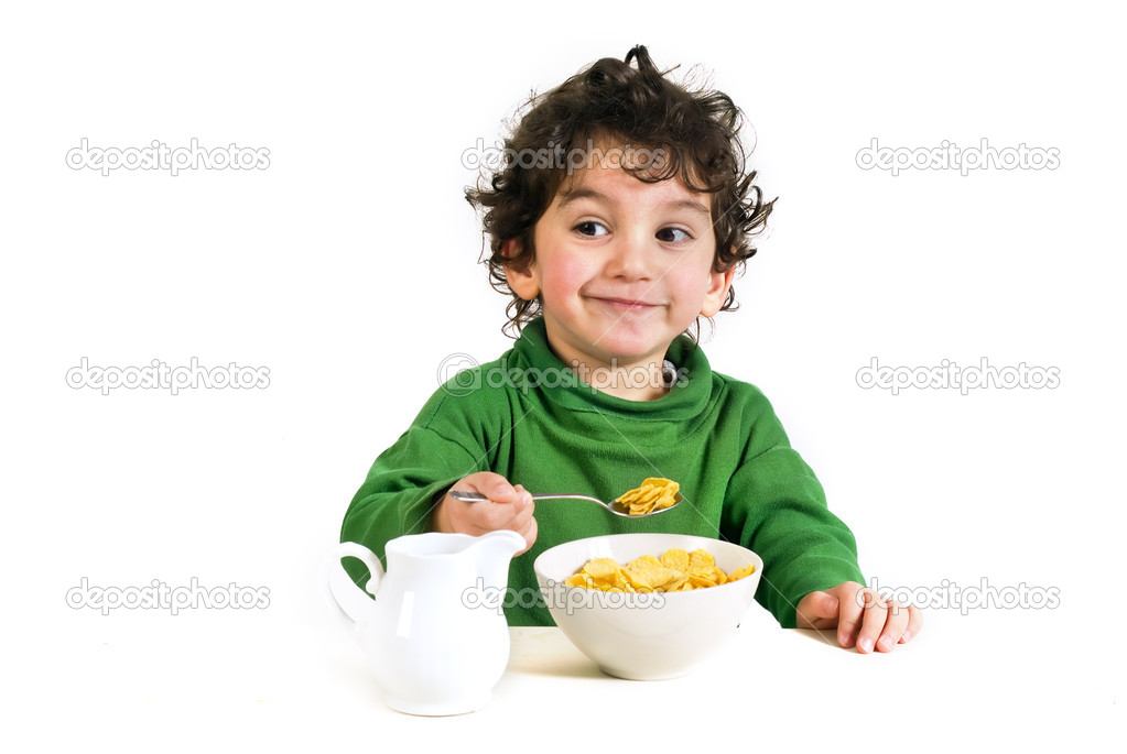 Young boy eating cereals isolated on white — Stok fotoğraf #1340938