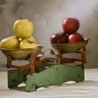 Old scales with yellow and red apples — Stock Photo #1408907