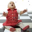 Stock Photo: Baby girl and confetti