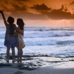 Girls beach sunset — Stock Photo