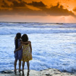 Girls beach sunset — Stock Photo